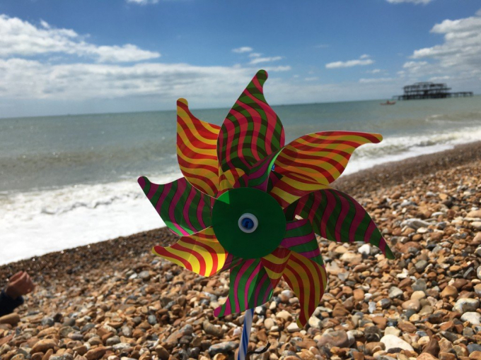 Toy windmill on beach