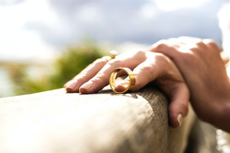 Women holding wedding ring