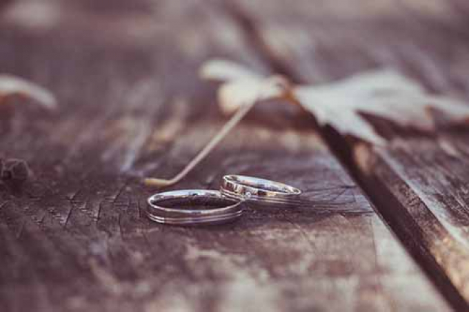 Two metal rings on wooden table