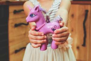 Girl with purple toy horse
