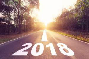 Road with 2018 and an arrow pointing forwards