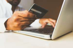 Man paying for something online using debit card