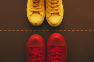 Red and yellow shoes on side of dotted line