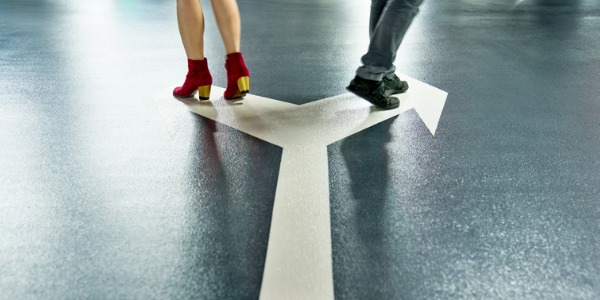 man and woman walking different direction after divorcing